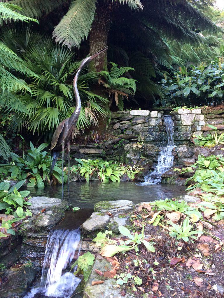 A water garden with ornamental heron