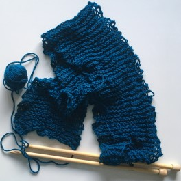 Knitted scarf on needles