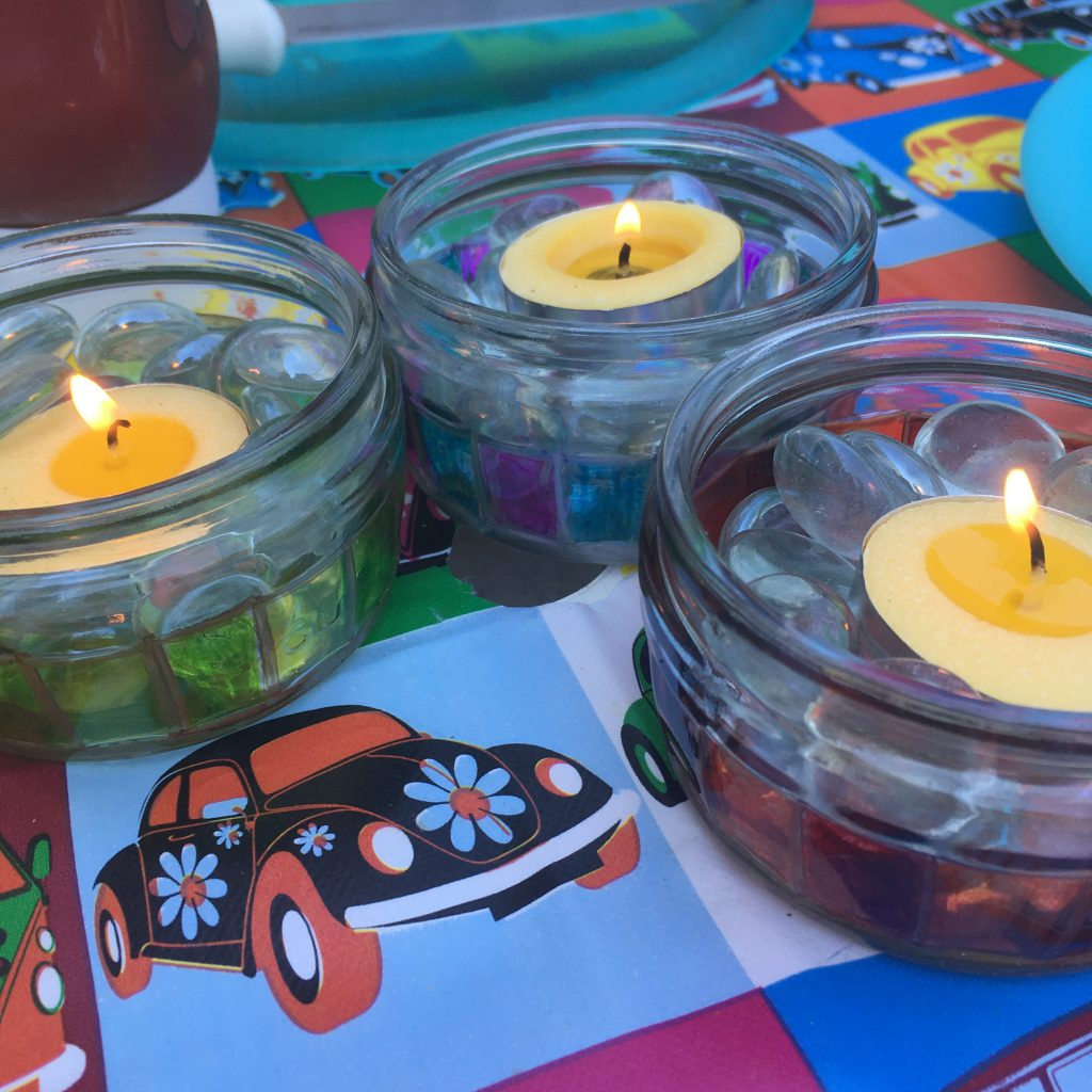 Upcycled candle jars in bright colours