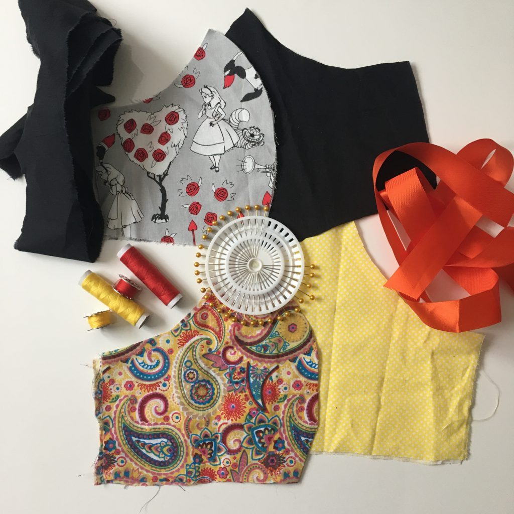 Fabric cut out for Face Masks with thread, pins and other materials
