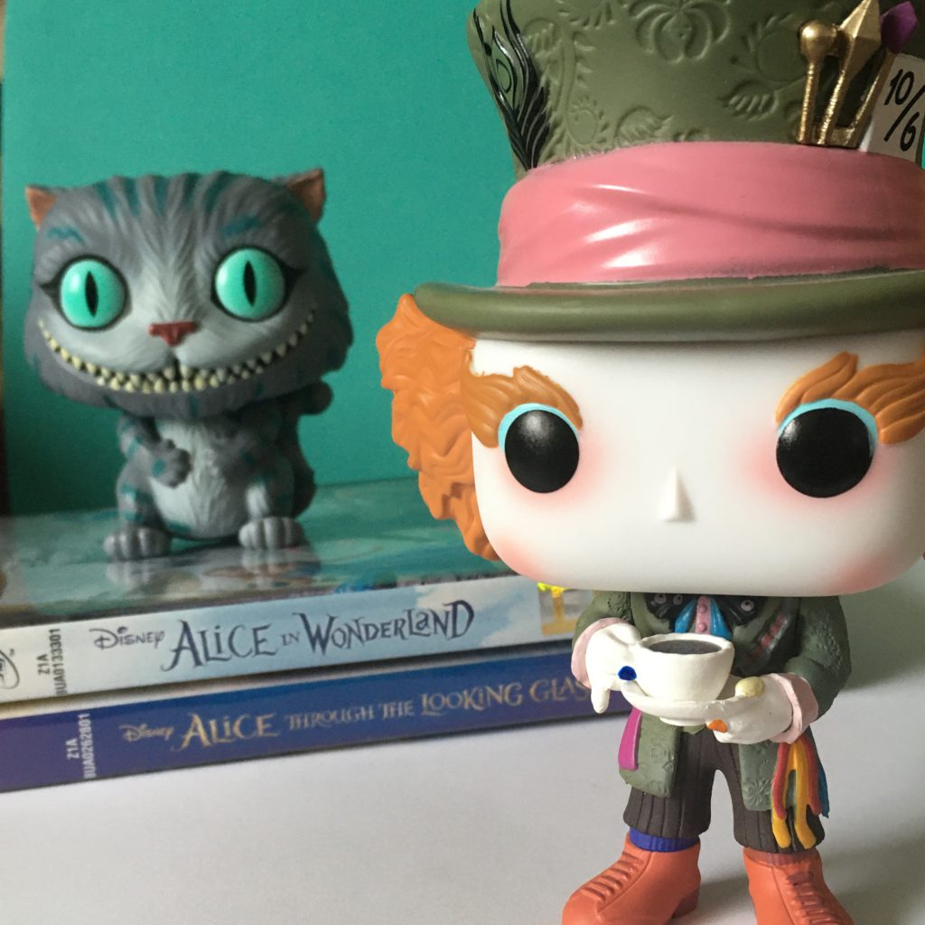 Spring Movie Favourites - Alice in Wonderland and Alice Through the Looking Glass DVDs with Cheshire Cat and Mad Hatter Funko Pops.