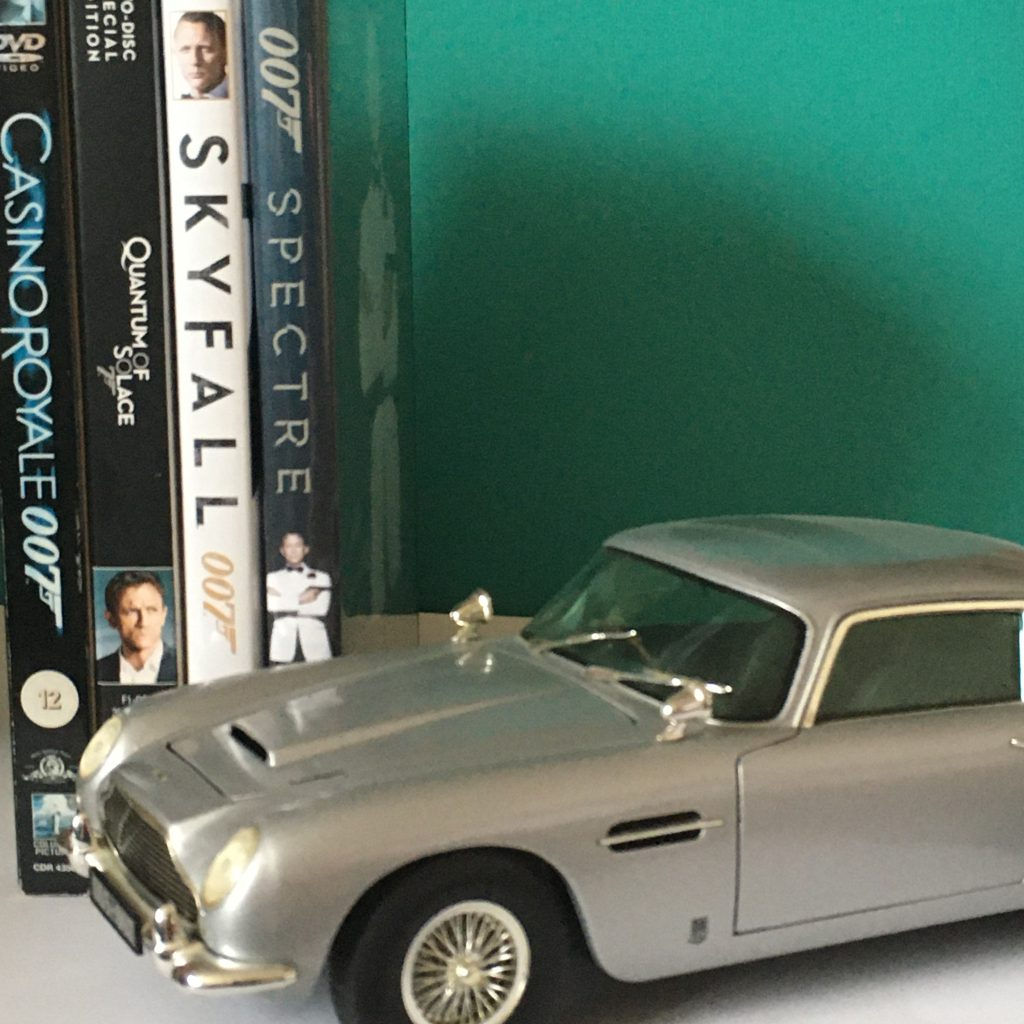 Spring Movie Favourites - Daniel Craig Bond Movies Casino Royale, Quantum of Solace, Skyfall and Spectre DVDs with model DB5 car.