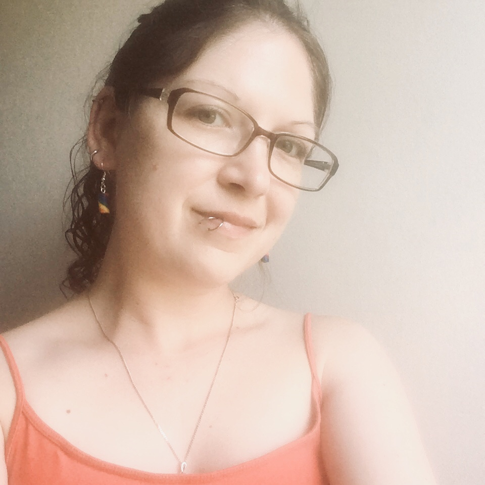 Kay wearing rainbow earrings from KelZo Jewellery