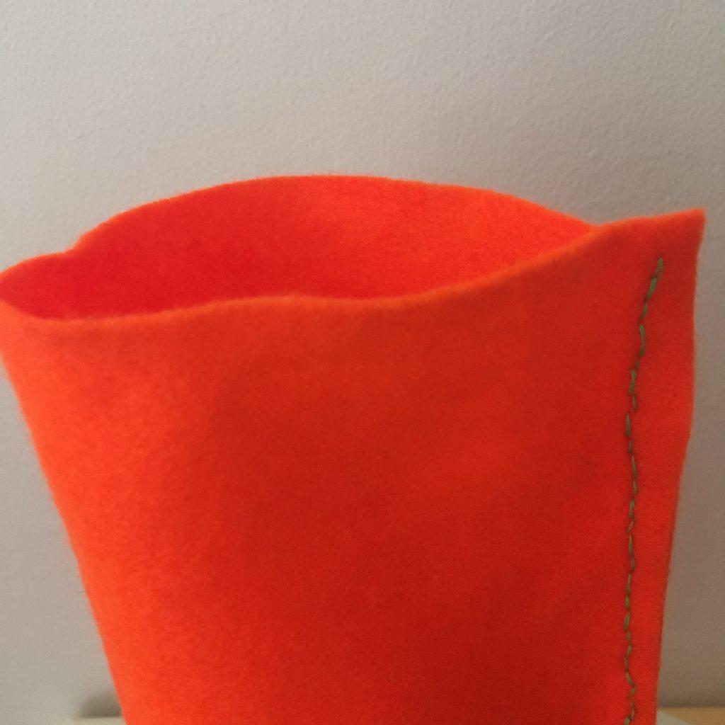 Sewing a hem to create a felt bottle wrap