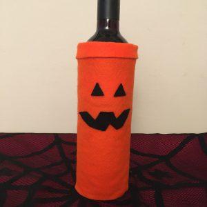Halloween crafts for adults -Pumpkin themed felt wine bottle wrap