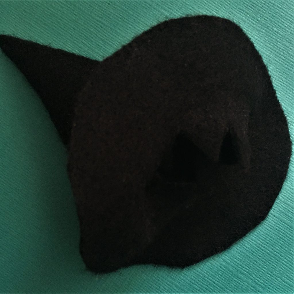 Felt witches hat bottle topper - on its side