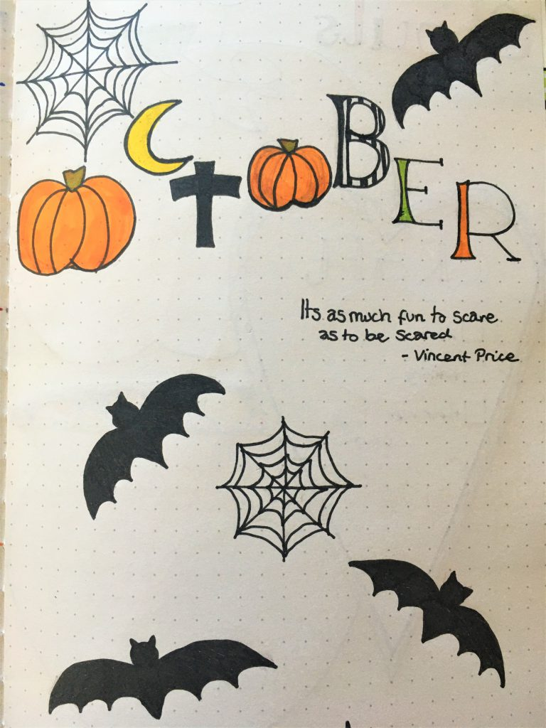 October Bujo title page, with pumpkins, bats and spiderwebs and other halloween imagery